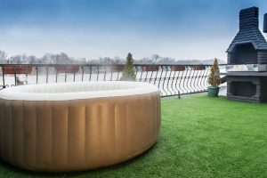 What can I put under my inflatable hot tub?